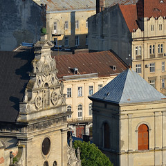 Lviv, faade details (Thomas Roland) Tags: summer sommer holiday travel ukraine  lvov lemberg city by stadt  oblast lviv europe europa historic center centre unesco world heritage church building architecture buildings house facades skyline square sq squared view udsigt town hall tower