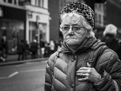A Bit Of An Animal (Leanne Boulton) Tags: people monochrome depthoffield urban street candid portrait portraiture streetphotography candidstreetphotography candidportrait streetportrait streetlife eyecontact candideyecontact elderly aged old woman female face facial expression eyes look emotion feeling mood atmosphere leopard print hat misery unhappy miserable sadness dour downturn mouth winter tone texture detail bokeh natural outdoor light shade shadow naturallight city scene human life living humanity society culture canon 7d 50mm black white blackwhite bw mono blackandwhite glasgow scotland uk character