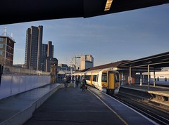 Arriving in the City (Henry Hemming) Tags: waterloo east train station london people commuters cold morning sun sunshine platform view eye