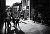 Drawn By The Light (h_cowell) Tags: mono monochrome bnw blackandwhite shadows street streetphotography candid noir silverefex panasonic gx7 shops shopping macclesfield cheshire uk people crowd walking striding texture appicoftheweek