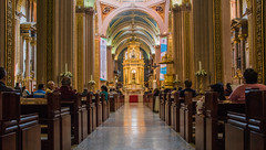2016 - Mexico - San Luis Potosi - Catedral Metropolitana - 2 of 2 (Ted's photos - Returns late December) Tags: 2016 cropped mexico nikon nikond750 nikonfx sanluispotosi tedmcgrath tedsphotos tedsphotosmexico vignetting aisle catedralmetropolitana catedralmetropolitanasanluispotosi sanluispotosicatedralmetropolitana church churchinterior pews seating seated seats sitting steps altar reflection arches stairs redrug redmat