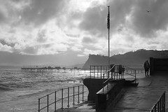 Life on the wall (Teignmouth Viewfinder) Tags: blackwhite seascapes wall sea headland coast waves pier person moody monochrome life sony a7