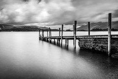 Jetty on Derwentwater (jasonmgabriel) Tags: bw white mountain lake black water monochrome clouds long exposure district jetty hills