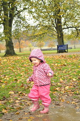 Splash (N'GOMAPHOTOGRAPHY) Tags: pink autumn playing leaves fun evelyn daughter wellingtonboots stamford puddles wellies splashing burghleyhouse