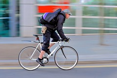 Put a rush on it (jeremyhughes) Tags: street city urban motion london bicycle speed work cycling movement nikon cyclist sigma riding singlespeed fixie fixedgear messenger courier panning rider bikemessenger courierbag fixedwheel 70200mmf28 cyclecourier d700
