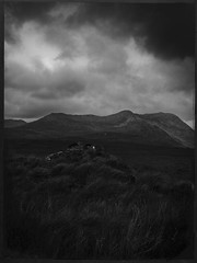 Ireland Cloudy Peak-BW (Firery Broome) Tags: travel ireland light sky blackandwhite mountains nature monochrome clouds photoshop dark landscape blackwhite europe moody dramatic eu stormy olympus lonely 365 lowkey 2008 cloudporn worldtravel naturelovers earthnature alienskin skyporn blackandwhitelandscape blackandwhitenature viveza exposure7 olympus570 sliderssunday