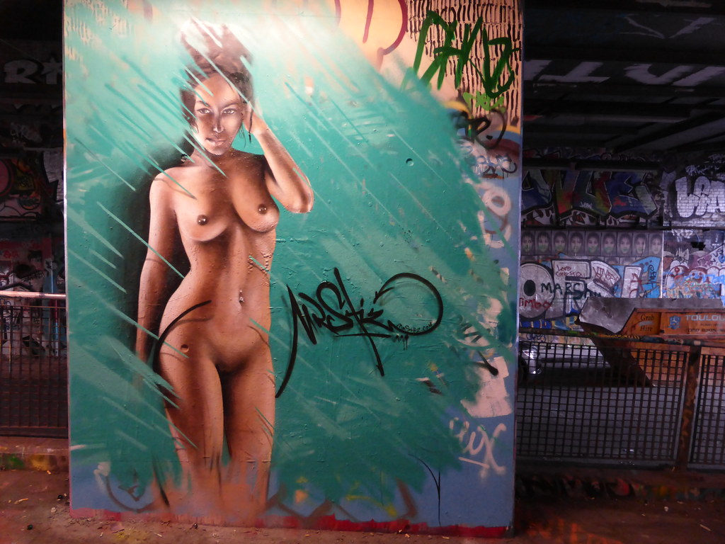 Once and girl naked with graffiti
