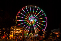 Swirls of Color (Back Road Photography (Kevin W. Jerrell)) Tags: ferriswheels nikond60 nightphotography lights theisland pigeonforge tennessee colorful nightshots fun