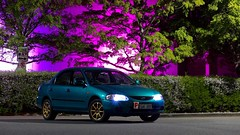 Ford Laser - Questacon (Exrone) Tags: city canberra australia tree podfilter bsa 18 race pplate 55mm m10 eos canon turbo blue gold green pink led jdm longexposure photography night questacon ford fordlaser