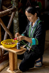 Hmong woman and homemade flowers (maryannenelson) Tags: thailand hmong women tradition people culture