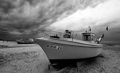 A storm is brewing (RafalZych) Tags: fishing vessel kuter rybacki fish beach bw czb wide wideangle nikon d90 sigma 1020 krynica morska storm burza boat dramatic sky