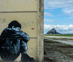 Beyond the Wall (Danny_Hodge) Tags: art graffiti boy wall waiting sitting sky view le mont saint michel france europe