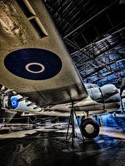 A Fly By Night (Steve Taylor (Photography)) Tags: wheel decal roundal propeller hanger wing art digital museum black blue grey metal newzealand nz southisland canterbury christchurch grain perspective texture airforce plane aeroplane aircraft wigram