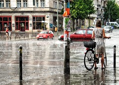 Berlin, all wet (Jfbp) Tags: berlin berlijn regen rain girl wet soaking natgeregend meisje fiets stortregen cats dogs duitsland germany