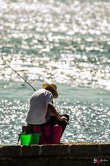 fisherman color (gillouvannes56) Tags: light sea sun mer seascape man water colors face portraits canon soleil fisherman brittany eau gulf lumière couleurs bretagne 7d pecheur morbihan contrejour golfe againstday