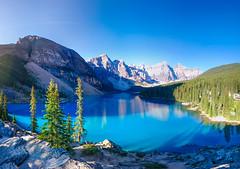 Moraine Lake, Banff National Park, AB (SpaceFlunky4) Tags: blue trees sky panorama sun lake snow canada mountains water rock contrast rocks view pano sony glacier alberta banff rise flour z3 xperia improvementdistrictno9