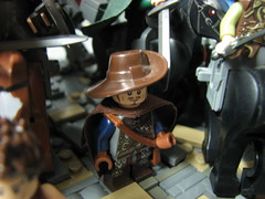 LoM UC: 2 (Micah the Fire-Breathing Hobbit) Tags: city roof horse statue wall soldier army riot hand lego stonework crowd medieval tudor cobblestone story fantasy hood cloak tale lom warg grueling