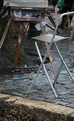 Abandoned...temporarily. (trailrunner55) Tags: paris france art chair artist montmartre painter easel wetpavement cigarettebutt emptychair