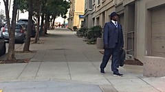 Lower Haight Business Man Fashion (Lynn Friedman) Tags: 94117 fashion man business hat suit tie walk sanfrancisco lynnfriedman walksf woonerven event spur 94105 advocacy nonprofit pedestriansafety missionst 94103
