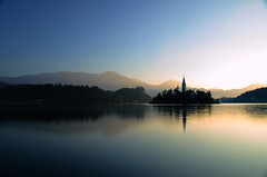 Silky, smooth Bled (A.Keskin) Tags: slovenia bled lake smooth reflection silky water blue sunrise sun sky colors mountains church island trees rays morning hdr landscape seascape longexposure