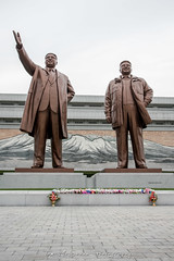 Huge Bronze statues of the former President's, Kim Il Sung and Kim Jung Il in Pyongyang, North Korea (DPRK) (tommcshanephotography) Tags: adventure asia communism dprk democraticpeoplesrepublicofkorea expedition exploring kimilsung kimjungil kimjungun northkorea pyongyang revolution secretcompass travel trekking