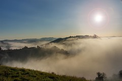 Island in a stormy sea (Jumpin'Jack) Tags: town city maribor slovenia completely covered with low lying autumn mist fog surrounding hills slovenskegorice sticking out bathed sun sunshine blue sky fall