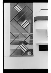 P34-2016-020 (lianefinch) Tags: argentique argentic bw blackandwhite noirblanc blackwhite film faade front window geometric gomtrique