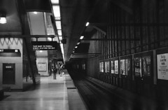 Between the hectic and mundane (m_travels) Tags: dark urban city 35mmfilm analogue blackandwhite filmphotography selfdeveloped analog argentique d76 chemicals homeprocessing developing kodaktrix400 bart station metro underground sanfrancisco kodakd76 traintracks glenpark sf architecture