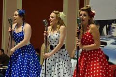 The PolkaDots (35mmMan) Tags: alexandra palace classic sports car show london polkadots trio retro vintage vocal singing singers group girls polkadottrio redwhiteandblue patriotic dresses female