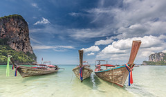 Upon a Summer Wind, there's a Certain Melody... (Jerry Fryer) Tags: krabiprovince thailand westrailaybeach longtailboats beach coast sea limestonecliffs turquoise clouds bluesky bw polariser 5dsr ef1635mmf4l