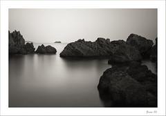 IMG_8577-Edit-Edit (zaom80) Tags: longexposure sea blackandwhite cliff rock canon monochromatic greece reef longtime parga eos450d sigma1770 nd1000