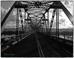 Bridge over the Columbia River (convertido) Tags: county bridge white black home clouds river island washington october afternoon shadows saturday columbia late puget 2015 spanning cathlamet wahkaikum
