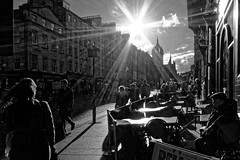 Royal Mile (scottprice16) Tags: street uk autumn people sun evening scotland blackwhite cafe edinburgh flare royalmile sunburst sigma1020mm contrejoure canoneos60d