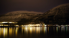 Arctic nights and city lights (lunaryuna) Tags: longexposure winter snow mountains norway night reflections season landscape mood colours le citylights fjord lunaryuna outskirts tromso northernnorway tromsfylke arcticregion arctictwilight seasonalwonders