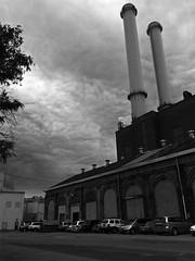 Ominous Skies (paulsvs1) Tags: brooklynnavyyard smokestacks foreboding architecture brooklyn blackandwhite clouds dark grit iphone5s nyc newyorkcity surreal sky streetphotography urban urbanphotography luminance