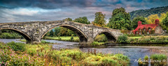 Llanrwst Bridge and Tea Room (Adrian Evans Photography) Tags: ivy autumn tuhwntirbont arch bridge water 15thcentury panorama bridgeofswearing wales llanrwstbridge teashop uk british architecture pontfawr window riverconwy conwyvalley path humpback vintage cottage llanrwst stream stone landmark stonebridge snowdonia outdoor sky tuhwntirbonttearooms entrance clouds forest riverbank river northwales victorian ancient virginiacreeper adrianevans pontyrhegi building landscape sign fall courthouse conwy nikon d800 20mm