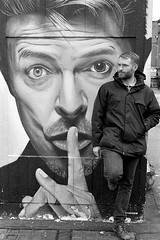 Street portrait of a man next to david bowie in Manchester (Black and White Street, Portrait Photographer) Tags: streetphotography streetportrait blackandwhiteanaloguephotograph leica m2 ilford delta 400
