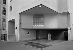 Overhang (geowelch) Tags: toronto ontario urbanlandscape urbanfragments city blackwhite 35mmfilm kodakt400cn c41 pentaxesii pentaxtakumarsmc28mm35 plustekopticfilm7400 newtopographics downtown
