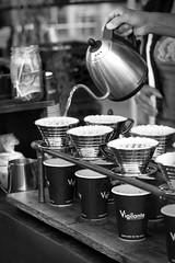 Fresh brewed from Vigilante Coffee (odonata98 (Kimberly Reinhart)) Tags: coffee blackandwhite bw cup cups mug caffene pour vigilante easternmarket kettle filter brew breakfast market outdoor coffeeshop washingtondc monochrome depth field depthoffield travel