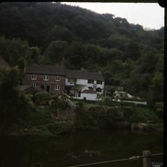 img113 (foundin_a_attic) Tags: house lake fishing wagon weels chimney brick july 1980