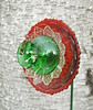 Holiday Flower (NiftyBitsGallery) Tags: garden art flower vintagegarden gardendecor outdoorgardendecor petals glass recycledart transformation floral design outdoorgarden outdoordecor homedecor holiday christmas ornament red green