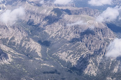 Somewhere Over Wyoming (T.M.Peto) Tags: wyoming mountains mountain mountainpeaks mountainridge clouds cloud flying flight airplanewindowshot planewindowshot windowseat abovetheclouds lookingdown geology aerial
