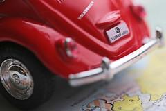 Macro Mondays, HMM (eleni m) Tags: macromondays hmm beetle toy car map red reflection wheel vw macro