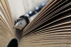 Paperback Writer (me.behindthelens) Tags: beatlesbeetles macromondays pen inkpen nib paperback book pages