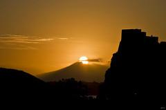 Sunrise behind the Vesuvio (Lorenoir) Tags: sky orange sun castle sunshine yellow sunrise pentax ngc naples vesuvio ischia castello isole castelloaragonese isolaverde isoladischia orangesunrise pentaxiani pentaxk50 sunriseatmosphere