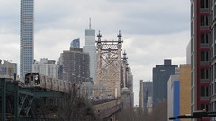 IMG_0658 (Sebastian Sinisterra Photography) Tags: new york city nyc bridge building lines clouds train buildings subway fun island long afternoon angle state cloudy towers wide 7 trains queens telephoto mta wtc leading queensboro nyct empie