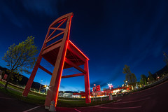 Big red chair blue hour (michael.taferner) Tags: blue red sky tree night clouds shopping stars eos lights big chair long exposure nacht outdoor tripod himmel wolken wideangle center krnten carinthia fisheye hour blau 8mm walimex stuhl lichter sterne langzeitbelichtung fokus blaue stativ villach atrio stunde 600d manuell apsc xxxlutz villaco