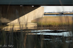 House floating in Grassy Sound from under the North Wildwood Bridge (artseejodee) Tags: county bridge house storm home weather bay iso200 may nj meadows f45 damage cape lowtide sunk 90mm stormdamage sinking beachhouse noreaster northwildwood capemaycounty grassysound 08260