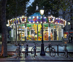 Carousel near Abbesses Metro station, Paris (Randy Durrum) Tags: bicycles bikes carousel abbesses paris france street lamp night eu europe durrum montmartre samsung s6