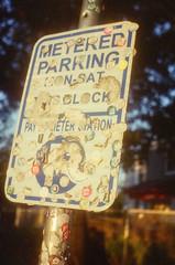 44990017 (alexdotbarber) Tags: sunset color analog 35mm sticker bokeh stickers rangefinder 1500 f4 kodakgold100 expiredfilm colorfilm colornegative petri7s houstonmuseumdistrict 45mmf28